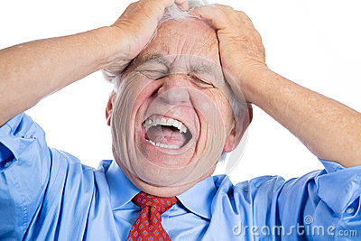 Handsome elderly man with white hair in blue shirt and red tie, stressed and frustrated with raging headache