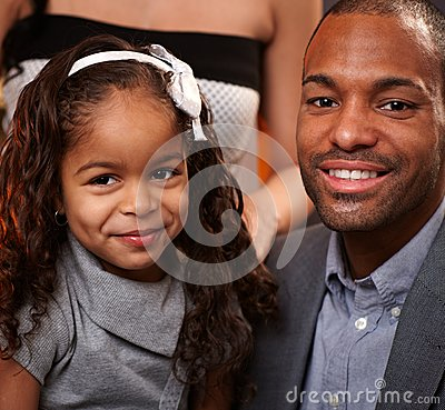 Handsome ethnic man and little daughter