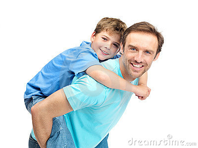 Handsome father giving son a piggyback ride