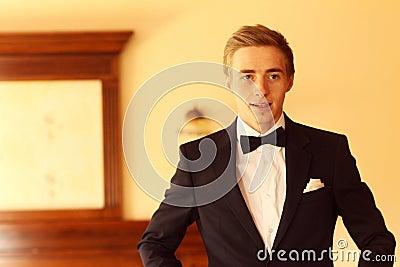 Handsome groom preparing for wedding