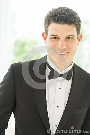Handsome Groom In Tuxedo Smiling