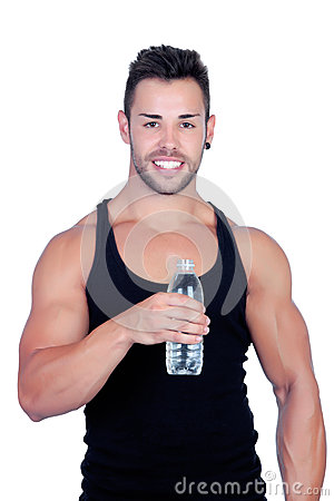 Handsome guy with muscles after sport drinking