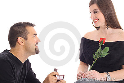 Handsome guy proposing with diamond