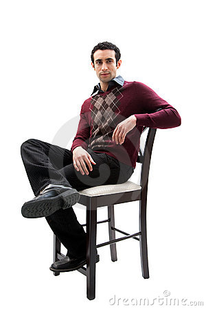 Handsome guy sitting on chair