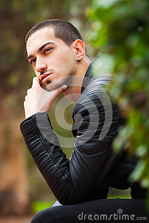 Free Handsome Guy Sitting Thinking. Short Hair Stock Images - 65285744