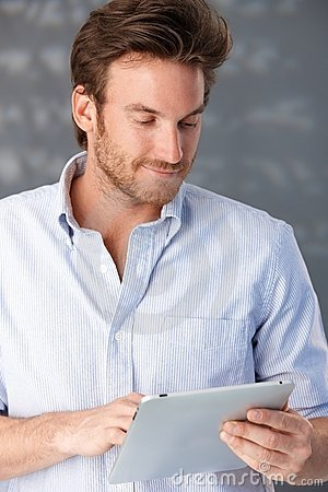 Handsome guy using touchscreen computer
