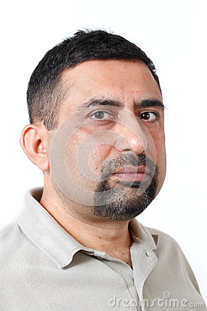 Handsome indian man face photo with cautious look