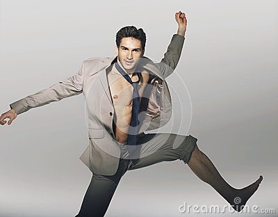 Handsome jumping guy with funny tie