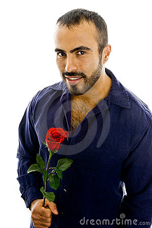 Handsome Latin guy offering rose