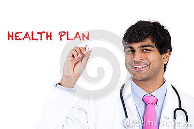 Handsome male health care professional or doctor or nurse writing the words  Health Plan