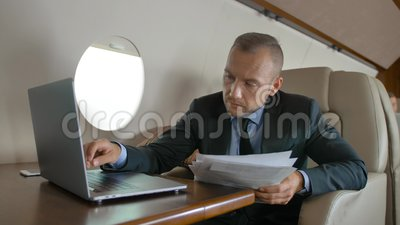 Handsome male with macbook surfing in Internet inside of luxury interior of private jet. Handsome male with macbook surfing in Internet inside of luxury interior stock video