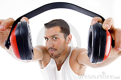 Handsome male showing headphone
