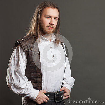 Free Handsome Male Steam Punk In A Leather Vest. Retro Man Portrait Over Gray Background. Royalty Free Stock Photography - 86570357