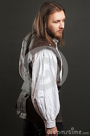 Free Handsome Male Steam Punk In A Leather Vest. Retro Man Portrait Over Gray Background. Royalty Free Stock Photos - 86570418