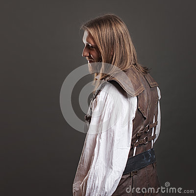 Free Handsome Male Steam Punk In A Leather Vest. Retro Man Portrait Over Gray Background. Royalty Free Stock Images - 86570579