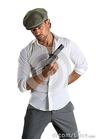 Handsome man in cap with a gun