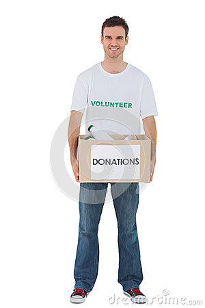 Handsome man carrying donation box with bottles