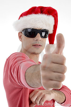 Handsome man with christmas hat wishing good luck