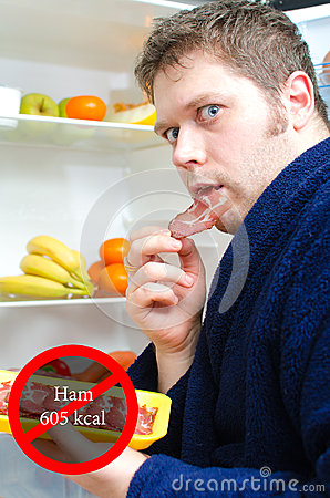 Handsome man eating ham