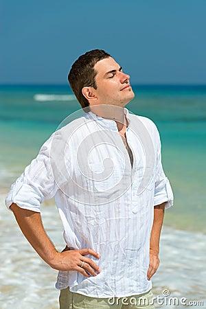 Handsome man enjoy vacation on a beach