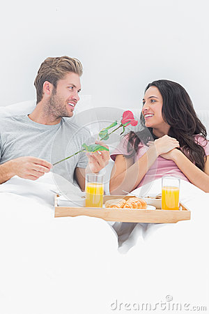 Handsome man giving a rose to his wife