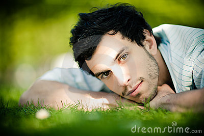 Handsome man on grass
