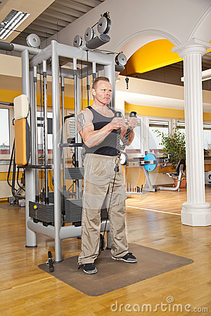 Handsome man in his forties exercising in gym