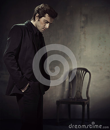 Free Handsome Man In A Business Suit On A Dark Background Stock Image - 28865031