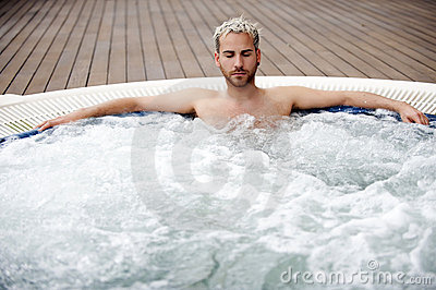 Handsome man in jacuzzi