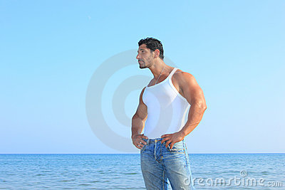 Handsome Man In Jeans By The Sea Royalty Free Stock Image - Image: 21658326