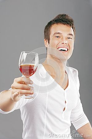 Handsome man lifts toast about wine