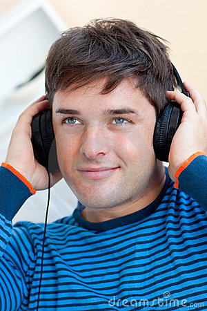 Handsome man listening music with earphones