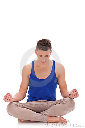 Handsome man meditating in lotus position