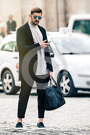 Free Handsome Man Model With Sunglasses And Cell Phone Outdoors Stock Photography - 66994612