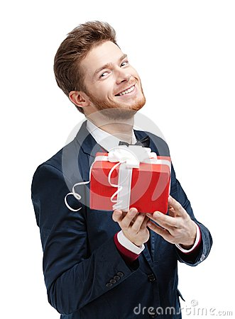 Handsome man offers a present