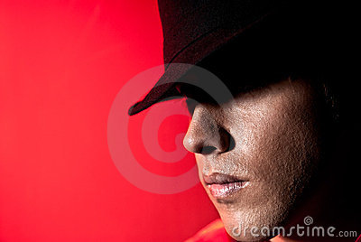 Handsome man portrait hat dark eyes mystery
