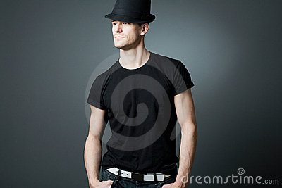 Handsome man posing in black t-shirt and bla