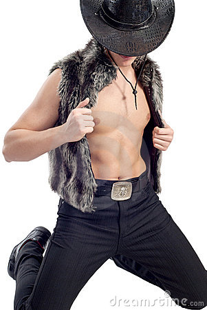 Handsome man posing in cowboy s hat