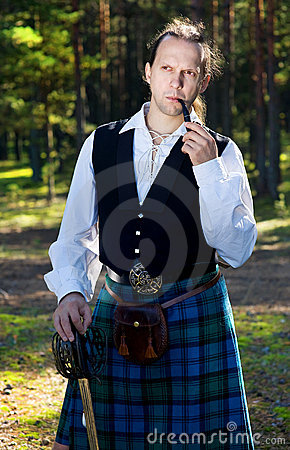 Handsome man in scottish costume