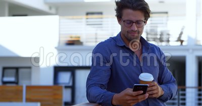 Handsome man sending a text and enjoying coffee 4k. Handsome man sending a text and enjoying coffee outside in 4k stock video footage