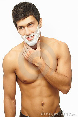 Handsome man shaving as part of morning routine