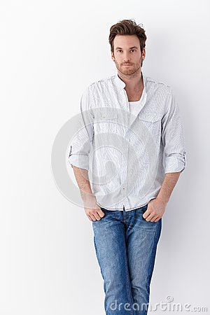 Handsome man in shirt and jeans