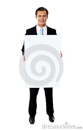 Handsome man showing billboard banner