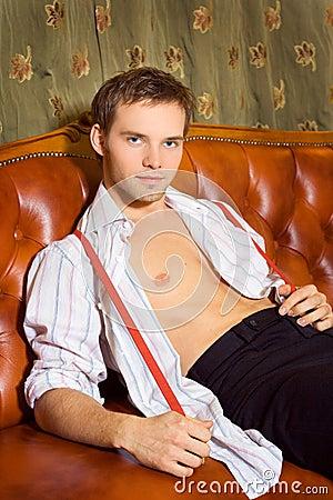 Handsome man sitting on sofa