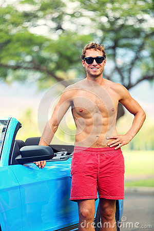 Handsome man with sports car