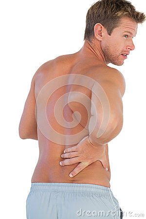Handsome man suffering from lower back pain