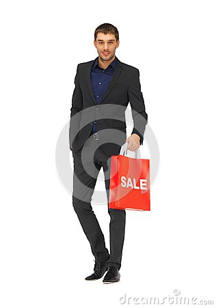 Handsome man in suit with sale sign