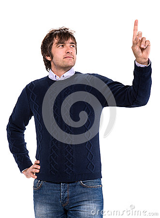 Handsome man in sweater pointing his finger up
