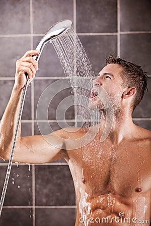 Handsome man taking a shower