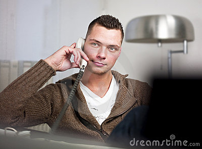 Handsome man with telephone